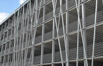 Stainless steel cable mesh are mounted to the outside of a building as facades for encourage plant growth.