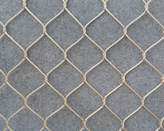 Stainless steel inter-woven cable mesh on the floor.