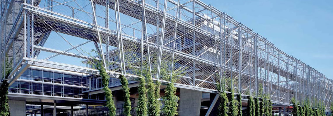 Building green facades, made of stainless steel cable mesh, are covering the surface of a building to provide ample growth room to the climbing plants.