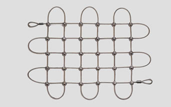 A piece of square cable mesh with cross clips
