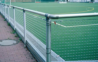 Square cable mesh around a football stadium to protect surrounding spectators.
